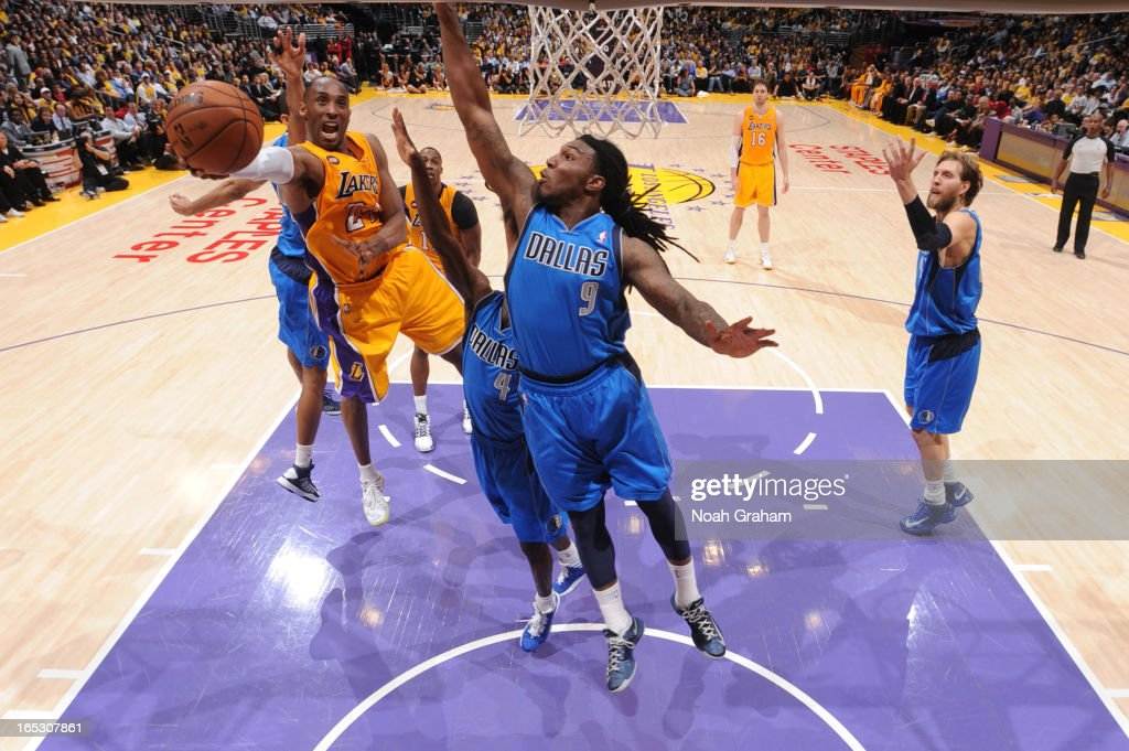 Kobe Bryant #24 of the Los Angeles Lakers attempts a shot against Jae Crowder #9 of the Dallas Mavericks at Staples Center on April 2, 2013 in Los Angeles, California.