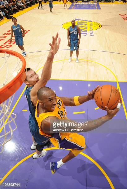 Kobe Bryant of the Los Angeles Lakers attempts a shot against Yi Jianlian of the Washington Wizards at Staples Center on December 7 2010 in Los...