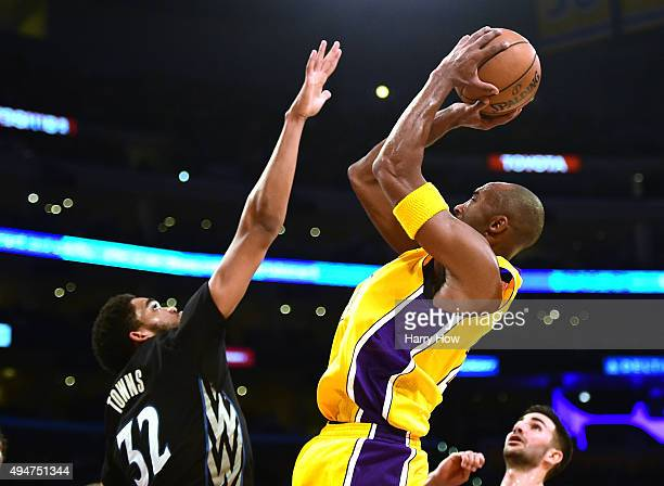 Kobe Bryant of the Los Angeles Lakers attempts a shot over KarlAnthony Towns of the Minnesota Timberwolves during the first quarter at Staples Center...