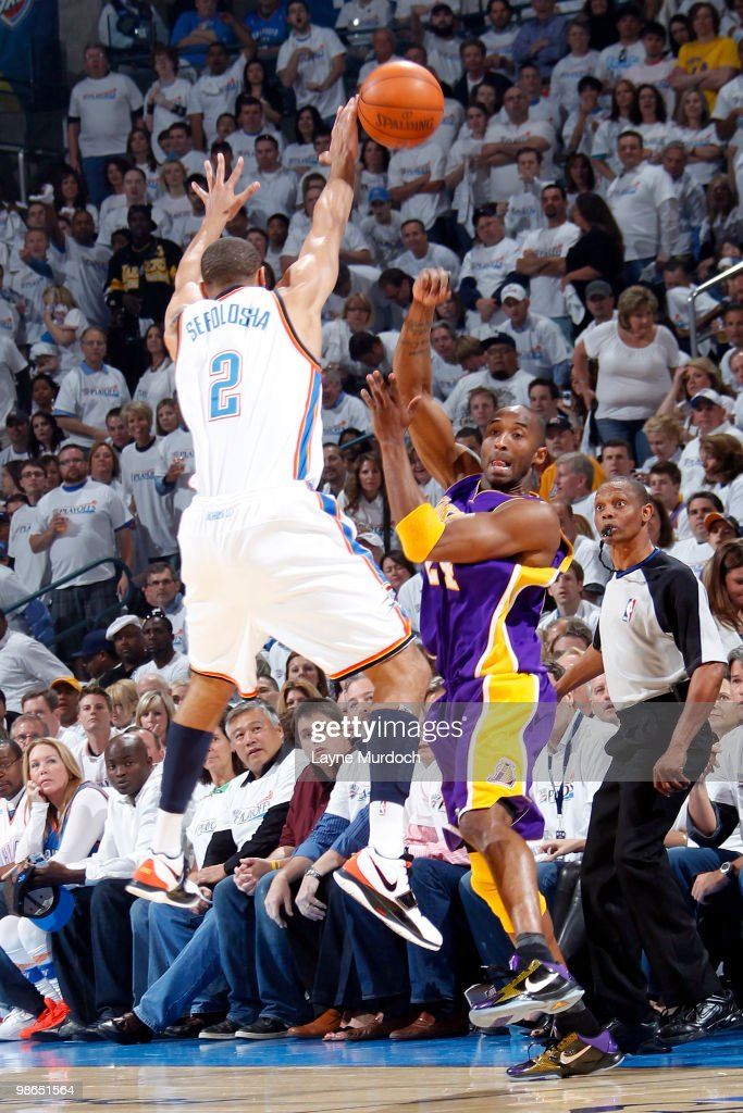 <a gi-track='captionPersonalityLinkClicked' href=/galleries/search?phrase=Kobe+Bryant&family=editorial&specificpeople=201466 ng-click='$event.stopPropagation()'>Kobe Bryant</a> #24 of the Los Angeles Lakers attempts to pass the ball around <a gi-track='captionPersonalityLinkClicked' href=/galleries/search?phrase=Thabo+Sefolosha&family=editorial&specificpeople=587449 ng-click='$event.stopPropagation()'>Thabo Sefolosha</a> #2 of the Oklahoma City Thunder in Game Four of the Western Conference Quarterfinals during the 2010 NBA Playoffs at Ford Center on April 24, 2010 in Oklahoma City, Oklahoma.