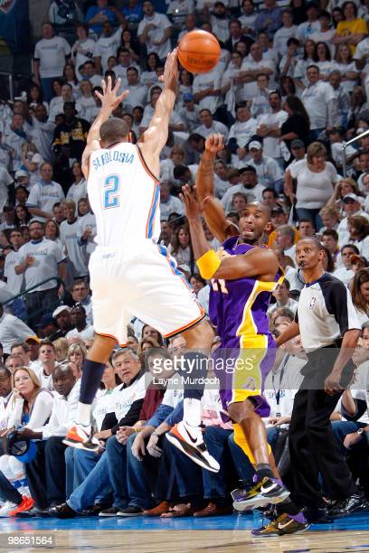 Kobe Bryant of the Los Angeles Lakers attempts to pass the ball around Thabo Sefolosha of the Oklahoma City Thunder in Game Four of the Western...