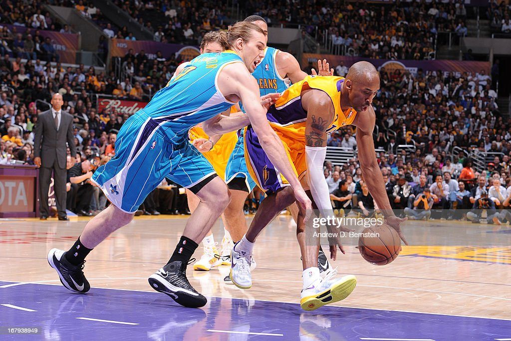 Kobe Bryant #24 of the Los Angeles Lakers attempts to pick up the loose ball against the New Orleans Hornets at Staples Center on April 9, 2013 in Los Angeles, California.