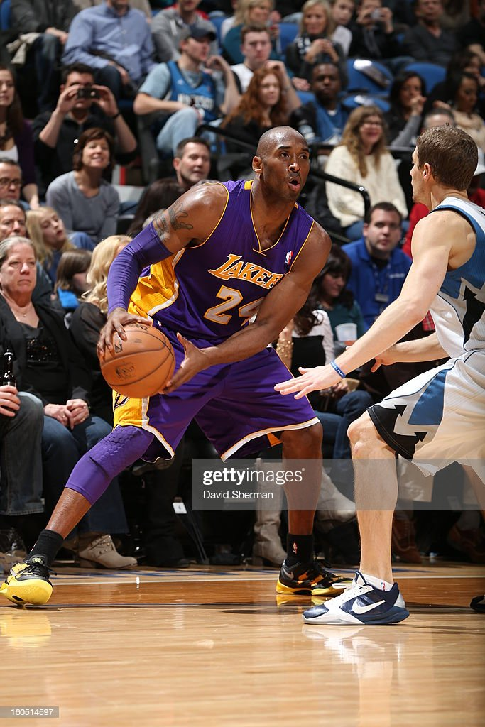 Kobe Bryant #24 of the Los Angeles Lakers backs up to the basket looking to pass the ball against the Minnesota Timberwolves during the game on February 1, 2013 at Target Center in Minneapolis, Minnesota.