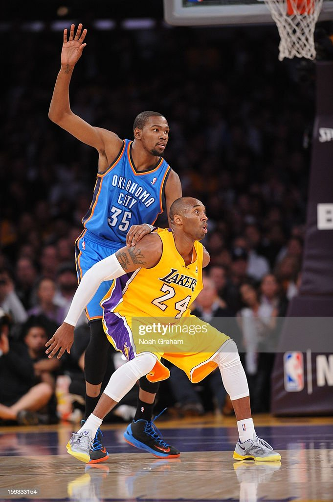 <a gi-track='captionPersonalityLinkClicked' href=/galleries/search?phrase=Kobe+Bryant&family=editorial&specificpeople=201466 ng-click='$event.stopPropagation()'>Kobe Bryant</a> #24 of the Los Angeles Lakers battles for position against <a gi-track='captionPersonalityLinkClicked' href=/galleries/search?phrase=Kevin+Durant&family=editorial&specificpeople=3847329 ng-click='$event.stopPropagation()'>Kevin Durant</a> #35 of the Oklahoma City Thunder at Staples Center on January 11, 2013 in Los Angeles, California.
