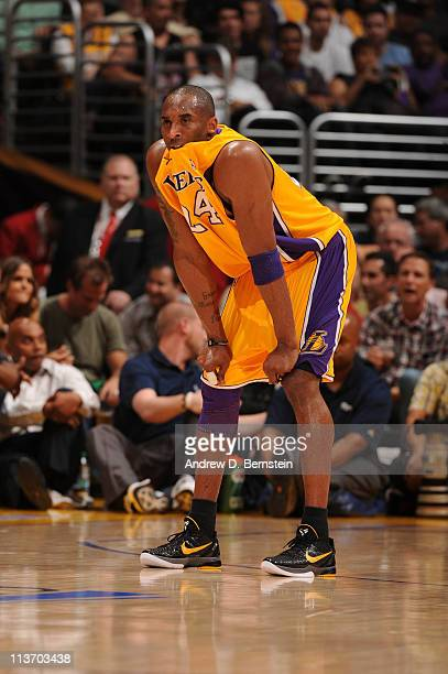 Kobe Bryant of the Los Angeles Lakers bites his jersey during a game against the Dallas Mavericks in Game Two of the Western Conference Semifinals in...