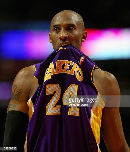 Kobe Bryant of the Los Angeles Lakers bites his jersey during a game against the Chicaog Bulls at the United Center on January 21 2013 in Chicago...