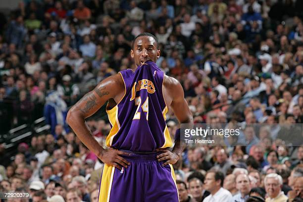 Kobe Bryant of the Los Angeles Lakers bites his jersey during the NBA game against the Dallas Mavericks on December 13 2006 at the American Airlines...