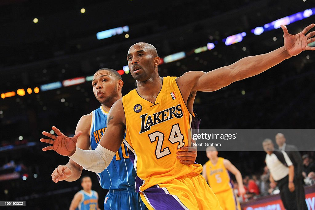 Kobe Bryant #24 of the Los Angeles Lakers calls for the ball against Eric Gordon #10 of the New Orleans Hornets at Staples Center on April 9, 2013 in Los Angeles, California.
