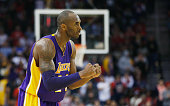 Kobe Bryant of the Los Angeles Lakers celebrates a play during their game against the Houston Rockets at the Toyota Center on November 19 2014 in...