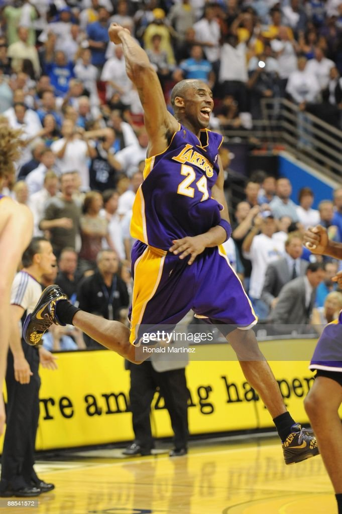 Kobe Bryant #24 of the Los Angeles Lakers celebrates after defeating the Orlando Magic in Game Five of the 2009 NBA Finals on June 14, 2009 at Amway Arena in Orlando, Florida. The Lakers won 99-86.