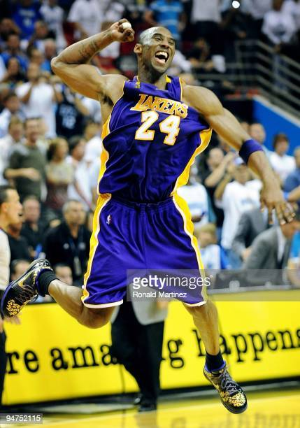 Kobe Bryant of the Los Angeles Lakers celebrates after defeating the Orlando Magic 9986 in Game Five of the 2009 NBA Finals on June 14 2009 at Amway...
