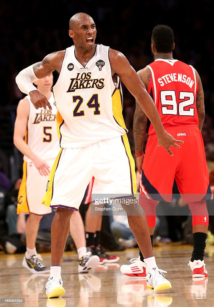 Kobe Bryant #24 of the Los Angeles Lakers celebrates after making a three point basket at the buzzer ending the third period against the Atlanta Hawks at Staples Center on March 3, 2013 in Los Angeles, California. The Lakers won 99-98.