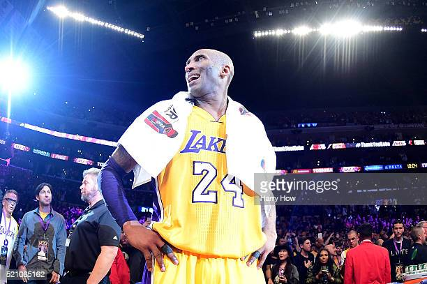 Kobe Bryant of the Los Angeles Lakers celebrates after scoring 60 points in his final NBA game at Staples Center on April 13 2016 in Los Angeles...