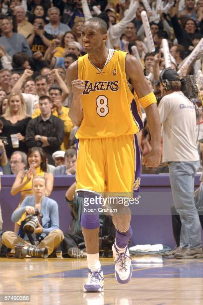 Kobe Bryant of the Los Angeles Lakers celebrates after winning against the Phoenix Suns in game three of the Western Conference Quarterfinals during...