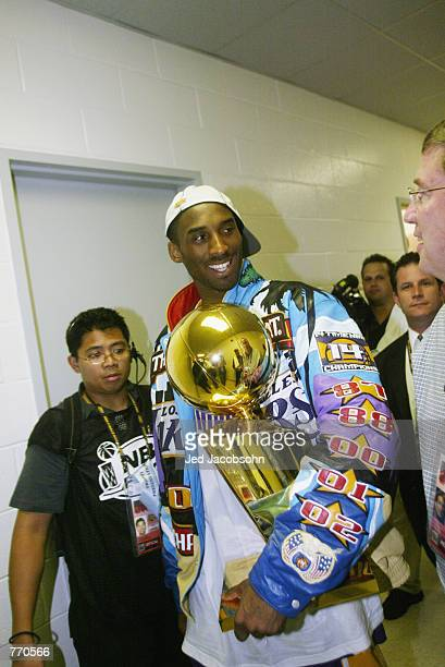 Kobe Bryant of the Los Angeles Lakers celebrates defeating the New Jersey Nets in Game four of the 2002 NBA Finals on June 12 2002 at Continental...