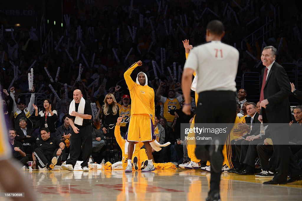 Kobe Bryant #24 of the Los Angeles Lakers celebrates from the sideline against the Portland Trail Blazers at Staples Center on December 28, 2012 in Los Angeles, California.