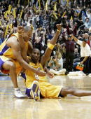 Kobe Bryant of the Los Angeles Lakers celebrates with Devean George after hitting the winning shot at the buzzer in the game against the Denver...