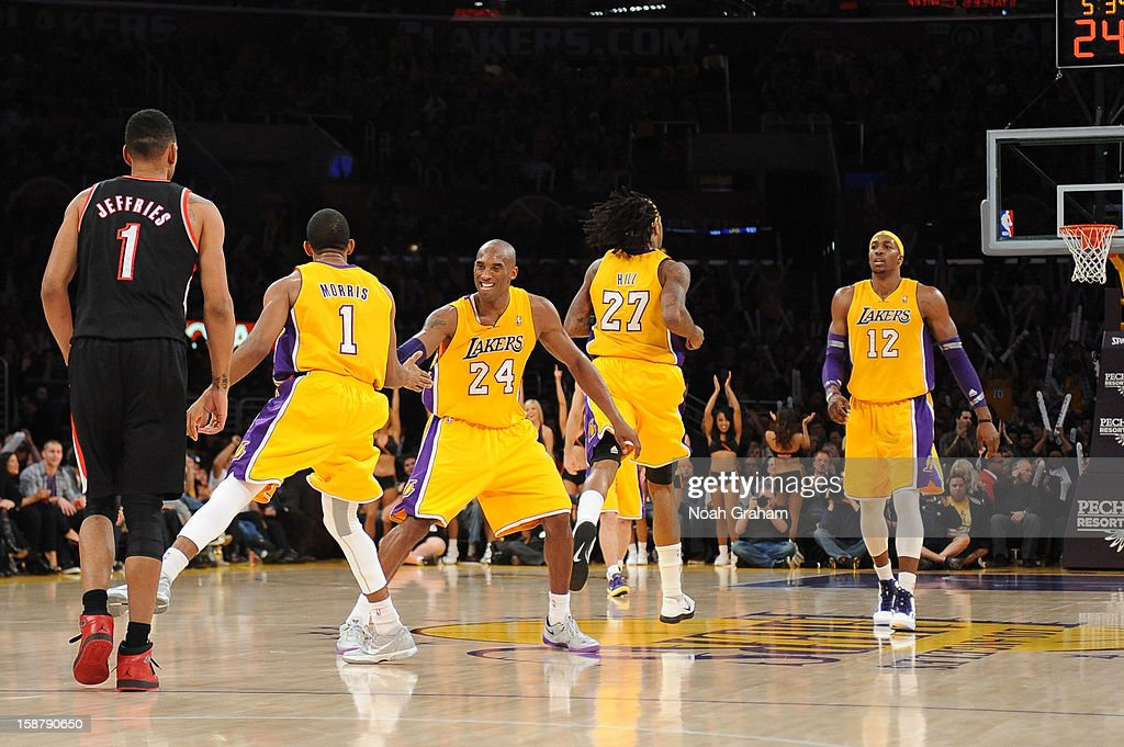 <a gi-track='captionPersonalityLinkClicked' href=/galleries/search?phrase=Kobe+Bryant&family=editorial&specificpeople=201466 ng-click='$event.stopPropagation()'>Kobe Bryant</a> #24 of the Los Angeles Lakers celebrates with teammate Darius Morris #1 during their game against the Portland Trail Blazers at Staples Center on December 28, 2012 in Los Angeles, California.
