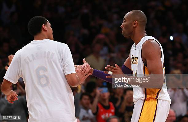 Kobe Bryant of the Los Angeles Lakers celebrates with teammate Jordan Clarkson after Bryant made a shot in the second half against the New York...