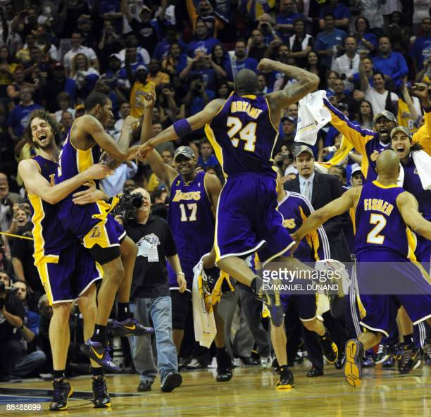 Kobe Bryant of the Los Angeles Lakers celebrates with teammates at the end of Game 5 in the NBA Finals against the Orlando Magic at Amway Arena on...
