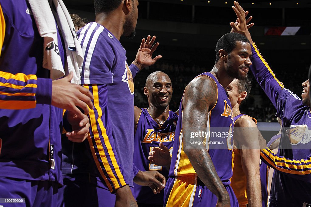 <a gi-track='captionPersonalityLinkClicked' href=/galleries/search?phrase=Kobe+Bryant&family=editorial&specificpeople=201466 ng-click='$event.stopPropagation()'>Kobe Bryant</a> #24 of the Los Angeles Lakers celebrates with teammates during the game against the Detroit Pistons on February 3, 2013 at The Palace of Auburn Hills in Auburn Hills, Michigan.