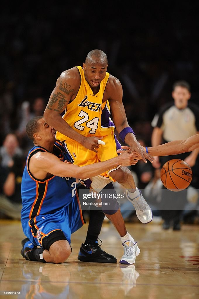 Kobe Bryant #24 of the Los Angeles Lakers chases after a loose ball against Thabo Sefolosha #2 of the Oklahoma City Thunder in Game Two of the Western Conference Quarterfinals during the 2010 NBA Playoffs at Staples Center on April 20, 2010 in Los Angeles, California.