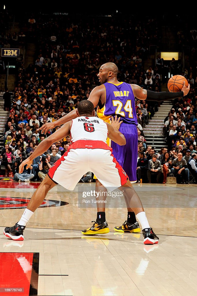 <a gi-track='captionPersonalityLinkClicked' href=/galleries/search?phrase=Kobe+Bryant&family=editorial&specificpeople=201466 ng-click='$event.stopPropagation()'>Kobe Bryant</a> #24 of the Los Angeles Lakers controls the ball against <a gi-track='captionPersonalityLinkClicked' href=/galleries/search?phrase=Alan+Anderson&family=editorial&specificpeople=3945355 ng-click='$event.stopPropagation()'>Alan Anderson</a> #6 of the Toronto Raptors on January 20, 2013 at the Air Canada Centre in Toronto, Ontario, Canada.