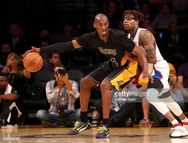 Kobe Bryant of the Los Angeles Lakers controls the ball against Chris DouglasRoberts of the Los Angeles Clippers at Staples Center on October 31 2014...