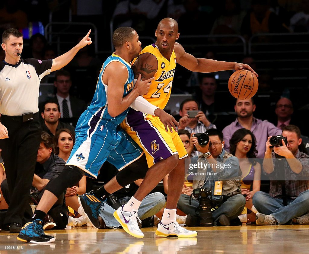 Kobe Bryant #24 of the Los Angeles Lakers controls the ball against Eric Gordon #10 of the New Orleans Hornets at Staples Center on April 9, 2013 in Los Angeles, California.