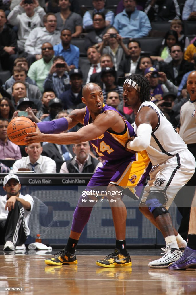 Kobe Bryant #24 of the Los Angeles Lakers controls the ball against Gerald Wallace #45 of the Brooklyn Nets on February 5, 2013 at the Barclays Center in the Brooklyn borough of New York City.