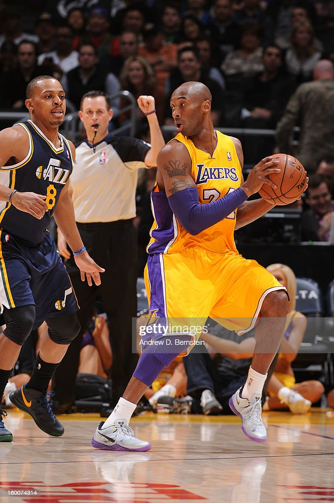 Kobe Bryant #24 of the Los Angeles Lakers controls the ball against Randy Foye #8 of the Utah Jazz at Staples Center on January 25, 2013 in Los Angeles, California.
