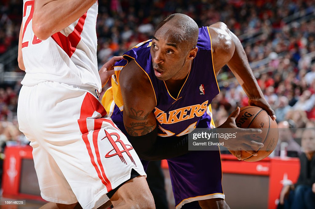 Kobe Bryant #24 of the Los Angeles Lakers controls the ball against the Houston Rockets on January 8, 2013 at the Toyota Center in Houston, Texas.