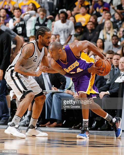 Kobe Bryant of the Los Angeles Lakers defends the ball against Kawhi Leonard of the San Antonio Spurs during the game on February 6 2016 at ATT...