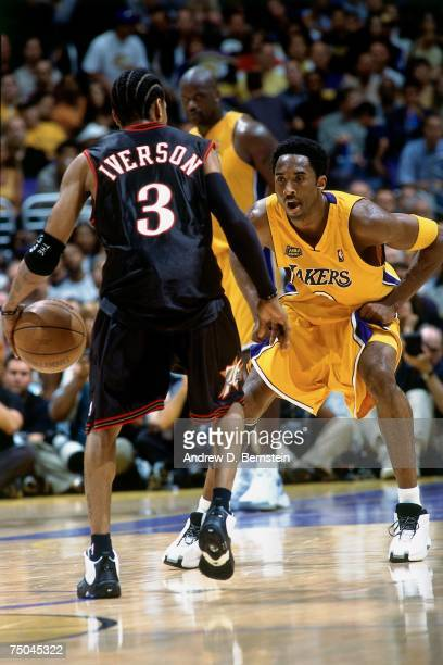 Kobe Bryant of the Los Angeles Lakers digs in on defense against Allen Iverson of the Philadelphia 76ers during a 2001 NBA game at the Staples Center...