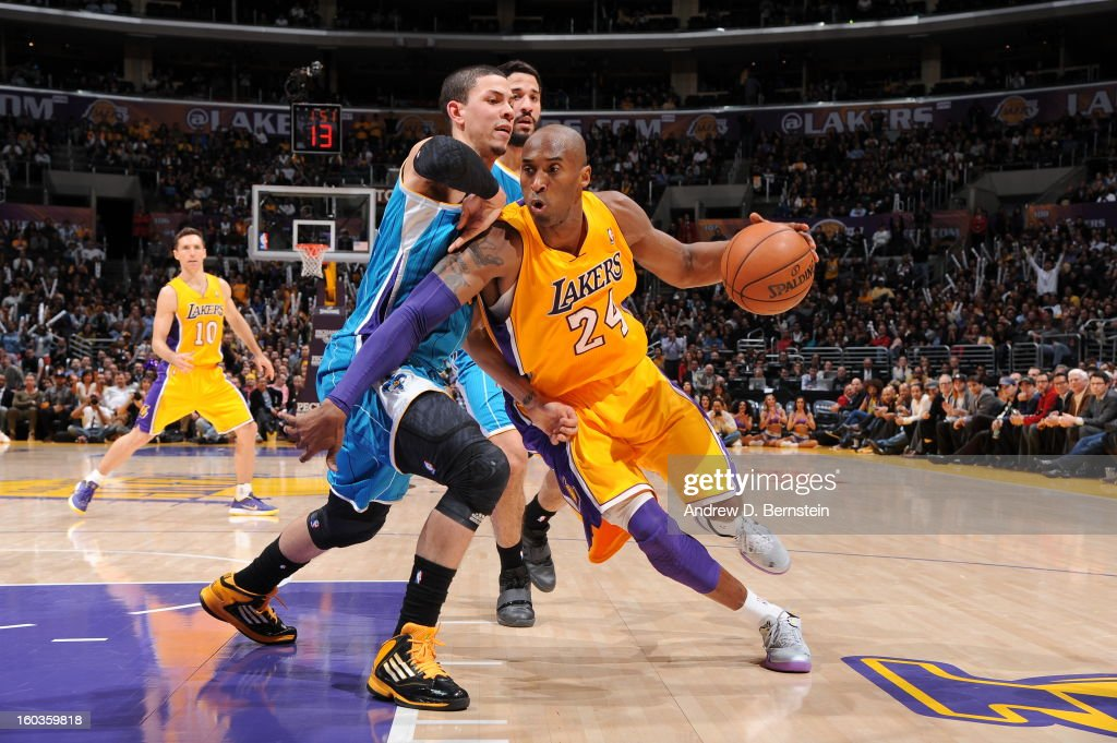 Kobe Bryant #24 of the Los Angeles Lakers dribbles against Austin Rivers #25 of the New Orleans Hornets at Staples Center on January 29, 2013 in Los Angeles, California.