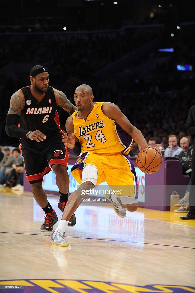 Kobe Bryant #24 of the Los Angeles Lakers dribbles against LeBron James #6 of the Miami Heat at Staples Center on January 15, 2013 in Los Angeles, California.
