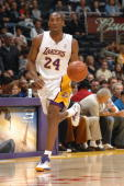 Kobe Bryant of the Los Angeles Lakers dribbles against the Seattle SuperSonics at Staples Center on April 15 2007 in Los Angeles California The...