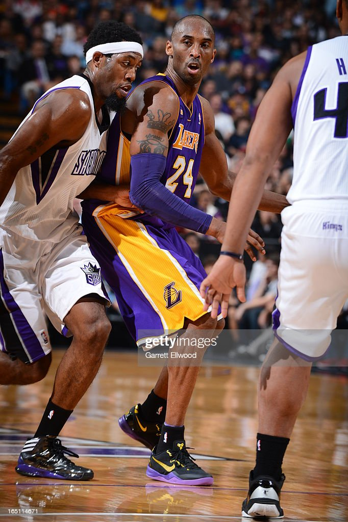 <a gi-track='captionPersonalityLinkClicked' href=/galleries/search?phrase=Kobe+Bryant&family=editorial&specificpeople=201466 ng-click='$event.stopPropagation()'>Kobe Bryant</a> #24 of the Los Angeles Lakers dribbles the ball against <a gi-track='captionPersonalityLinkClicked' href=/galleries/search?phrase=John+Salmons&family=editorial&specificpeople=202524 ng-click='$event.stopPropagation()'>John Salmons</a> #5 of the Sacramento Kings on March 30, 2013 at Sleep Train Arena in Sacramento, California.
