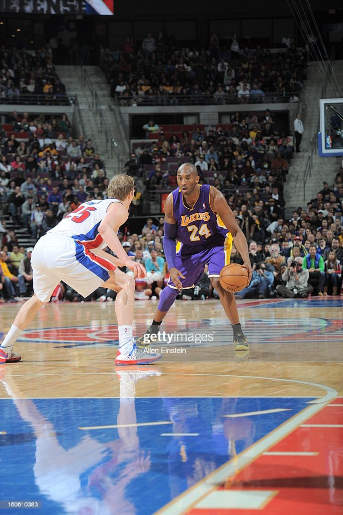 Kobe Bryant #24 of the Los Angeles Lakers dribbles the ball against Kyle Singler #25 of the Detroit Pistons during the game on February 3, 2013 at The Palace of Auburn Hills in Auburn Hills, Michigan.