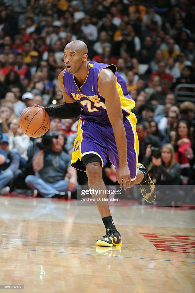 <a gi-track='captionPersonalityLinkClicked' href=/galleries/search?phrase=Kobe+Bryant&family=editorial&specificpeople=201466 ng-click='$event.stopPropagation()'>Kobe Bryant</a> #24 of the Los Angeles Lakers dribbles the ball up the floor against the Los Angeles Clippers at Staples Center on January 4, 2013 in Los Angeles, California.