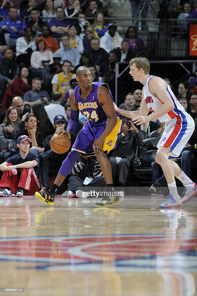 Kobe Bryant #24 of the Los Angeles Lakers dribbles the ball while looking to pass against Kyle Sigler #25 of the Detroit Pistons during the game on February 3, 2013 at The Palace of Auburn Hills in Auburn Hills, Michigan.
