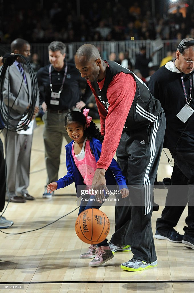 Kobe Bryant #24 of the Los Angeles Lakers dribbles with his daughter during the NBA All-Star Practice in Sprint Arena at Jam Session at Jam Session during NBA All Star Weekend on February 16, 2013 at the George R. Brown Convention Center in Houston, Texas.