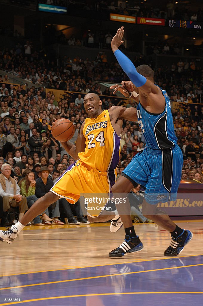 <a gi-track='captionPersonalityLinkClicked' href=/galleries/search?phrase=Kobe+Bryant&family=editorial&specificpeople=201466 ng-click='$event.stopPropagation()'>Kobe Bryant</a> #24 of the Los Angeles Lakers drives against <a gi-track='captionPersonalityLinkClicked' href=/galleries/search?phrase=Dwight+Howard&family=editorial&specificpeople=201570 ng-click='$event.stopPropagation()'>Dwight Howard</a> #12 of the Orlando Magic at Staples Center on January 16, 2009 in Los Angeles, California.