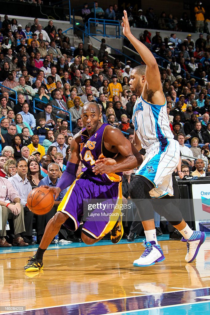 Kobe Bryant #24 of the Los Angeles Lakers drives against Eric Gordon #10 of the New Orleans Hornets on March 6, 2013 at the New Orleans Arena in New Orleans, Louisiana.