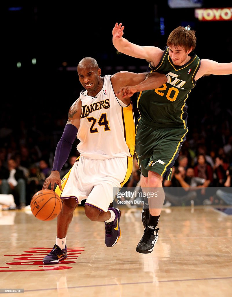 Kobe Bryant #24 of the Los Angeles Lakers drives against Gordon Hayward #20 of the Utah Jazz at Staples Center on December 9, 2012 in Los Angeles, California. The Jazz won 117-110.