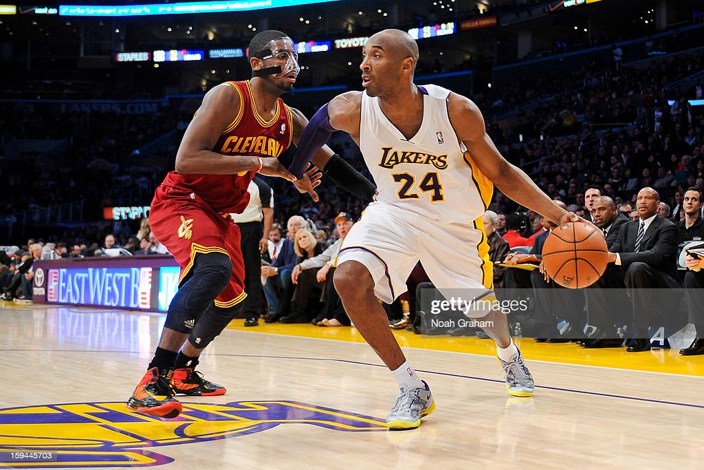 <a gi-track='captionPersonalityLinkClicked' href=/galleries/search?phrase=Kobe+Bryant&family=editorial&specificpeople=201466 ng-click='$event.stopPropagation()'>Kobe Bryant</a> #24 of the Los Angeles Lakers drives against <a gi-track='captionPersonalityLinkClicked' href=/galleries/search?phrase=Kyrie+Irving&family=editorial&specificpeople=6893971 ng-click='$event.stopPropagation()'>Kyrie Irving</a> #2 of the Cleveland Cavaliers at Staples Center on January 13, 2013 in Los Angeles, California.