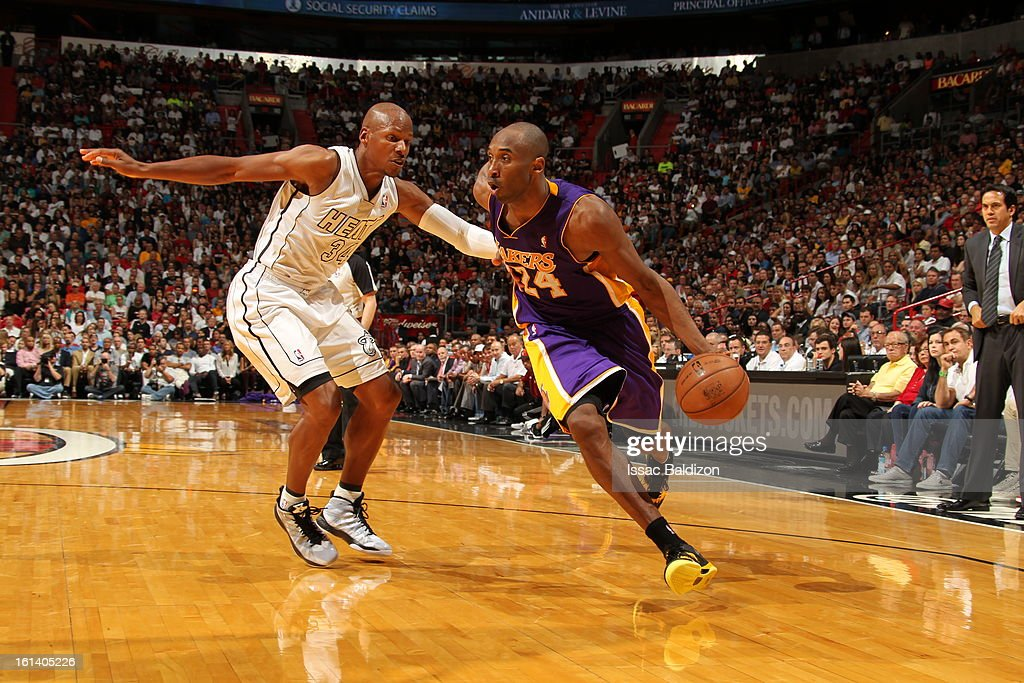Kobe Bryant #24 of the Los Angeles Lakers drives against Ray Allen #34 of the Miami Heat during a game between the Los Angeles Lakers and the Miami Heat on February 10, 2013 at American Airlines Arena in Miami, Florida.