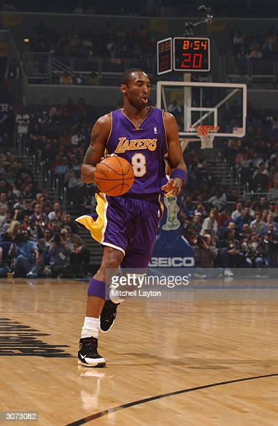 Kobe Bryant of the Los Angeles Lakers drives against the Washington Wizards during the game at MCI Center on February 28 2004 in Washington DC The...