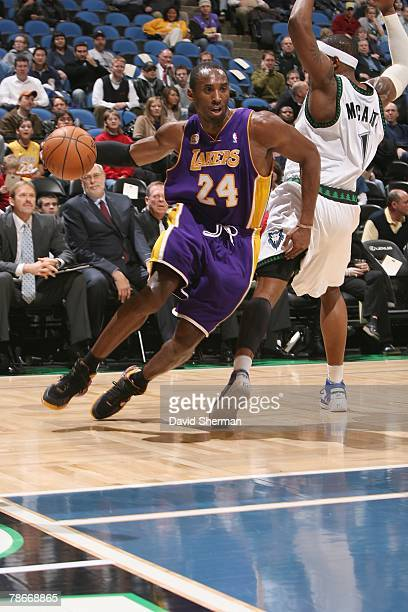 Kobe Bryant of the Los Angeles Lakers drives around Rashad McCants of the Minnesota Timberwolves during the game on December 4 2007 at the Target...