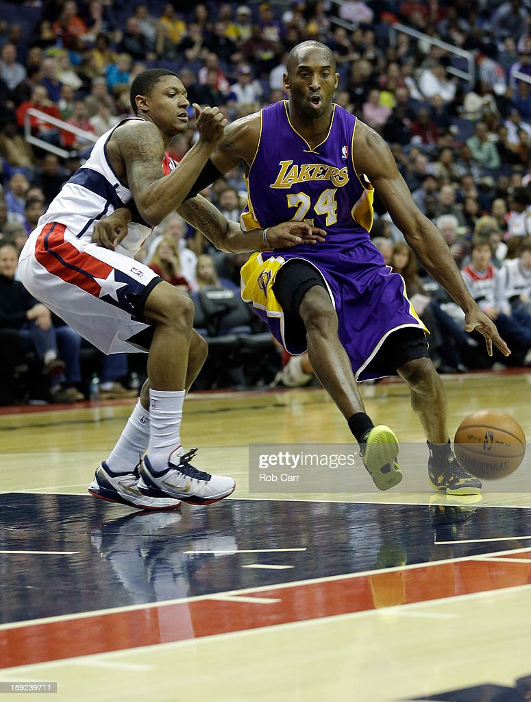 <a gi-track='captionPersonalityLinkClicked' href=/galleries/search?phrase=Kobe+Bryant&family=editorial&specificpeople=201466 ng-click='$event.stopPropagation()'>Kobe Bryant</a> #24 of the Los Angeles Lakers drives around <a gi-track='captionPersonalityLinkClicked' href=/galleries/search?phrase=Trevor+Ariza&family=editorial&specificpeople=201708 ng-click='$event.stopPropagation()'>Trevor Ariza</a> #1 of the Washington Wizards at Verizon Center on December 14, 2012 in Washington, DC.